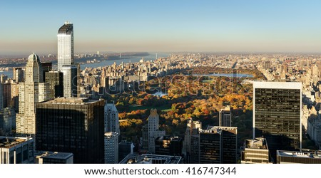 Panoramic aerial view on Central Park in fall colors with Midtown skyscrapers, Upper West Side buildings and the George Washington Bridge in the distance. Manhattan, New York City - stock photo