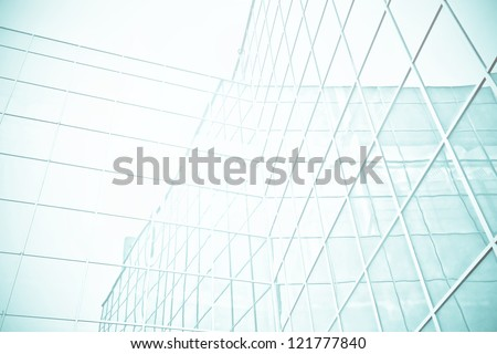 Panoramic and perspective wide angle view to steel blue background of glass high rise building skyscrapers in modern futuristic downtown at night - stock photo