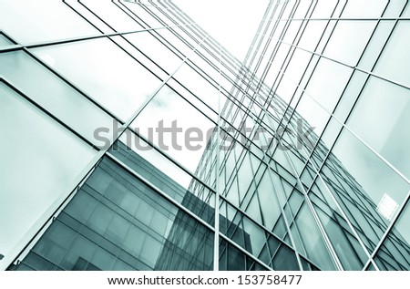 Panoramic and perspective wide angle view to steel blue background of glass high rise building skyscrapers in modern futuristic downtown at night Business concept of successful industrial architecture