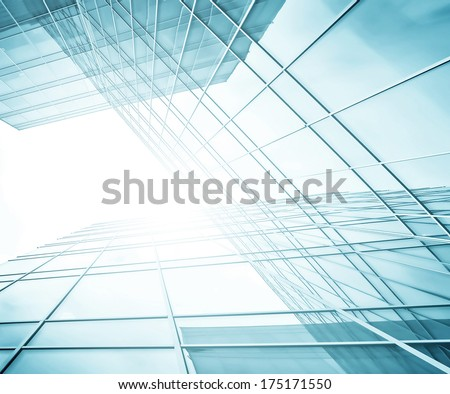 Panoramic and perspective wide angle view to steel light blue background of glass highrise building skyscraper, modern futuristic commercial city Business concept of successful industrial architecture - stock photo