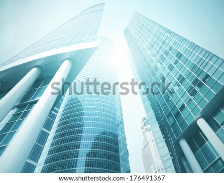 Panoramic and perspective wide angle view to steel light blue background of glass highrise building skyscraper, modern futuristic commercial city Business concept of successful industrial architecture