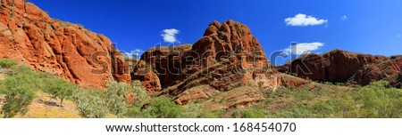 Panoramic Australian landscape with geological feature of rolling hills. The Dragon hill. Bungle Bungle national park, Western Australia,. Australia - stock photo
