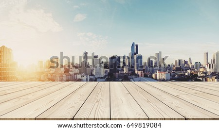 Panoramic Bangkok cityscape in sunrise with empty wooden floor