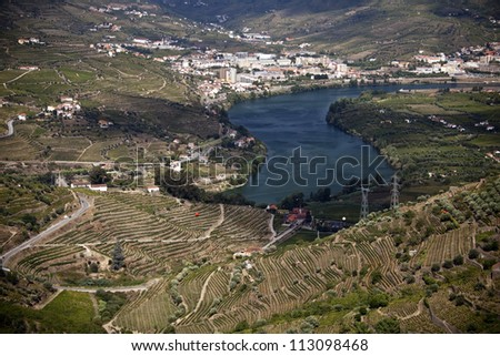 Panoramic beautiful view to the Douro Valley in Portugal and the terraced vineyards of grapes from which the Porto wine is produced - stock photo