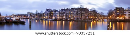 Panoramic city scenic with the Thiny Bridge at twilight in Amsterdam the Netherlands