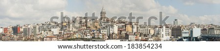 Panoramic cityscape over the Bosphorus River in Istanbul Turkey with a large residential area and Galata Tower - stock photo