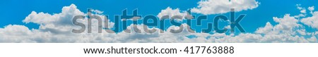 panoramic cloudscape with blue sky background