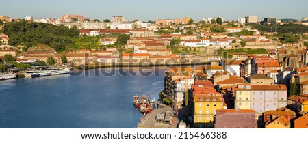 Panoramic colorful view on the old city of Porto, Portugal, with vintage quaint houses along the river Douro and part of Unesco heritage sites - stock photo