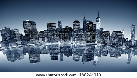 panoramic curved night view of New York City with reflection in water