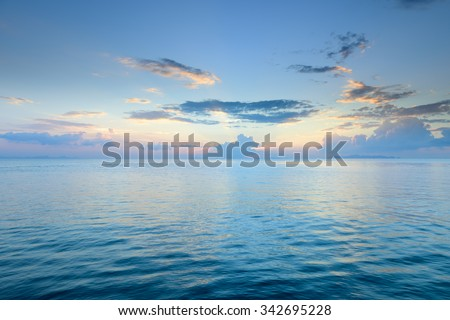 Panoramic dramatic sunset sky and tropical sea at dusk background - stock photo