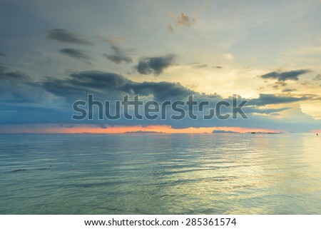 Panoramic dramatic sunset sky and tropical sea at dusk,space for text - stock photo