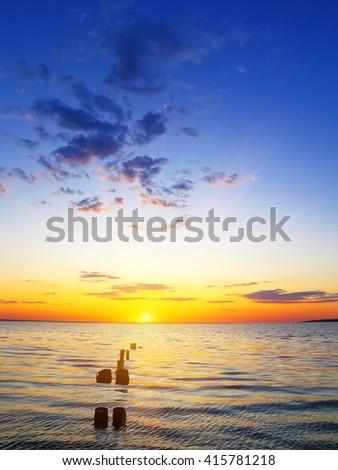 Panoramic dramatic sunset sky over sea at dusk - stock photo