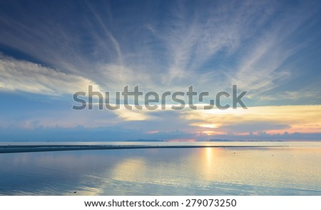 Panoramic dramatic tropical sea sky sunset background - stock photo