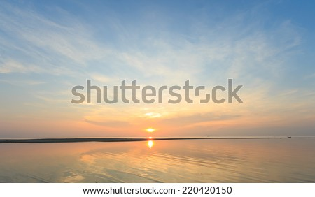 Panoramic golden sunset sky and tropical sea at dusk  - stock photo