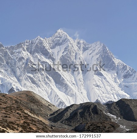 Panoramic high resolution view of the Nuptse wall (top 7864 m) and Lhotse peak (8516 m) - Mt. Everest region, Nepal