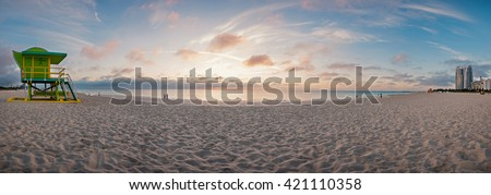 Panoramic image 180 degrees of world famous travel location, Miami beach, Florida. Lifeguard tower in a typical colorful Art Deco style and Atlantic Ocean at sunshine. - stock photo