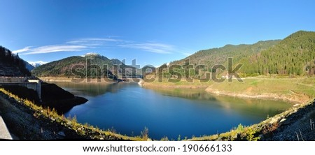 Panoramic image from the shore of a Green and Blue Mountain ,Retezat mountain,Romania