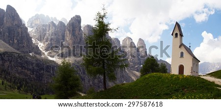Panoramic image of a chapel with mountain view in the background, Passo Gardena, Dolomite Mountains, Italy - stock photo