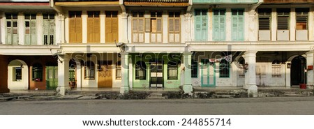 Panoramic image of a row of heritage houses in sunlight, George Town, Penang, Malaysia - stock photo