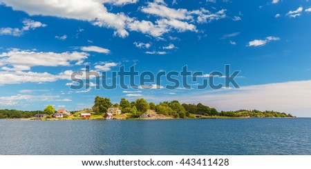 Panoramic image of a small swedish island with old wooden houses in the province of Blekinge - stock photo