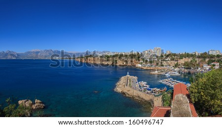Panoramic Image of Antalya Harbour with Blue Sky and Taurus Mountains