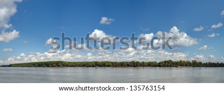 Panoramic image of beautiful blue Danube. Trees are on the other side of the river. Made from several frames stitched together to achieve very high resolution. - stock photo