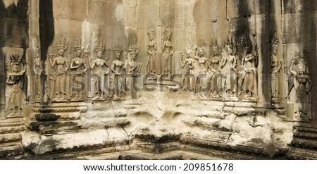 Panoramic image of Devata's at Angkor Wat Temple, Cambodia - stock photo
