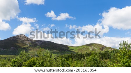 Panoramic image of Great Sugar Loaf and Carrigoona Commons - stock photo