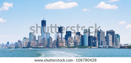 Panoramic image of lower Manhattan skyline from Staten Island Ferry boat, New York City. - stock photo