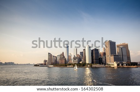 Panoramic image of lower Manhattan skyline with reflections.