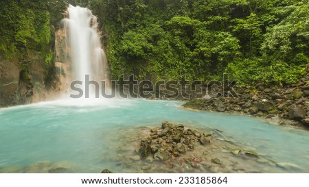 Panoramic image of the cerulean blue waters of the Rio Celste Waterfall in Volcan Tenoria National Park, COsta Rica. - stock photo