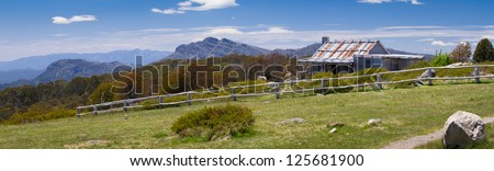 Panoramic image of the iconic Craig's Hut (as seen in the Man from Snowy River movie) in the Victorian alps, Australia - stock photo