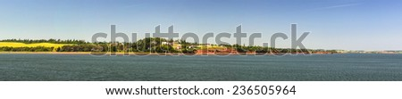Panoramic landscape coastal view near Cavendish, Prince Edward Island, Canada, with red cliffs. - stock photo