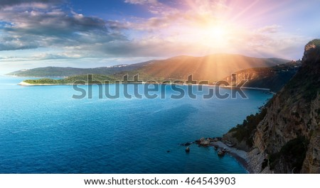Panoramic landscape of the rocky coastline sea and Jaz Beach at sunshine. Budva, Montenegro. Adriatica. Top view.
