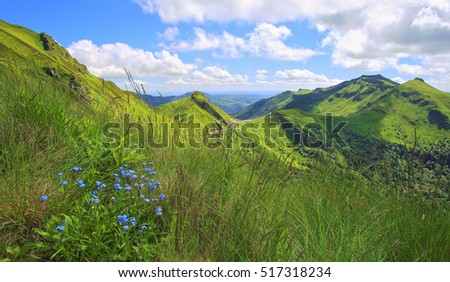 Panoramic landscape of volcanic mountains (Puy de Sancy, Massif Central, France)