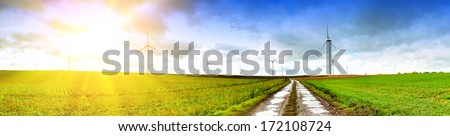 Panoramic landscape with country road and wind turbines  - stock photo