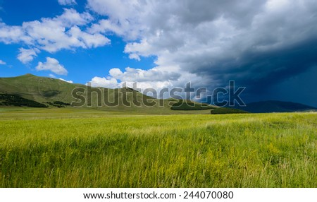 Panoramic landscape with dramatic clouds - stock photo