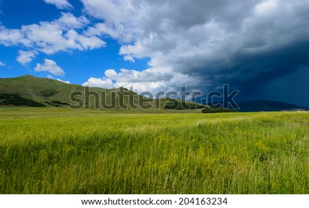 Panoramic landscape with dramatic sky - stock photo