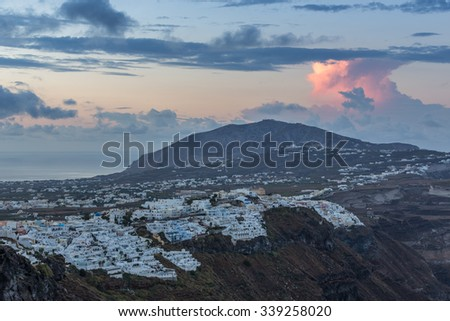 Panoramic large view from the highest village over the island of Santorini, Greece, with Firostefani, Fira and town of Pyrgos in sight - stock photo