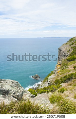 Panoramic lookout from plateau over ocean at Bass Strait, Tasmania, Australia, view to horizon with mountains and copy space. - stock photo