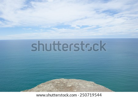 Panoramic lookout over ocean at Bass Strait, Tasmania, Australia, at edge of rocky platform, view to horizon and copy space. - stock photo