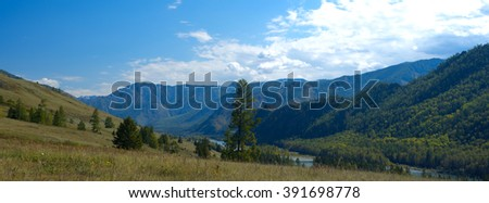 Panoramic mountain landscape in a summer day - stock photo