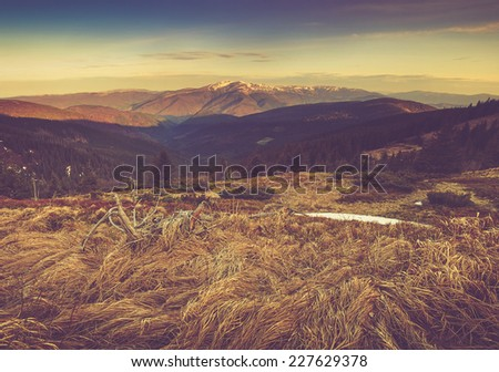 Panoramic mountain landscape in autumn. Filtered image:cross processed vintage effect.  - stock photo