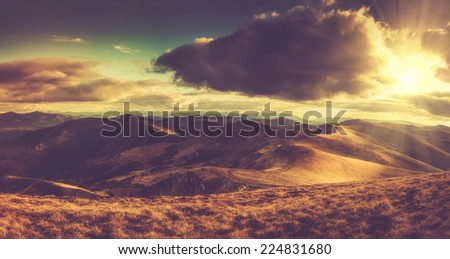 Panoramic mountain landscape in autumn with sunlight. Filtered image:cross processed vintage effect.  - stock photo