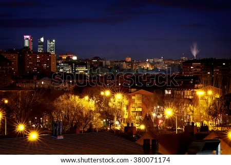 "Panoramic Night View of Madrid, Spain. Photo taken from the hills of ""Tio Pio Park"", ""Vallecas"". - stock photo"