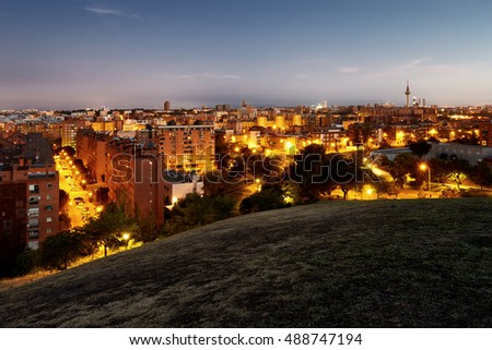 "Panoramic night view of Madrid, Spain. Photo taken from the hills of ""Tio Pio Park"", ""Vallecas""."