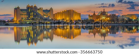 Panoramic nocturnal view on central beach of Eilat. In Israel, Eilat is a famous city with beautiful beaches and resort hotels packed with thousands of relaxing tourists from all around of the world - stock photo