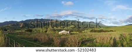 Panoramic of a Beautiful Valley and Farmland in New Zealand - stock photo