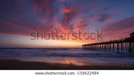 Panoramic of Kitty Hawk Pier House at sunrise in the Outer Banks