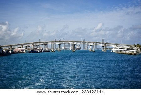 Panoramic of modern bridge over the ocean connecting the luxurious Paradise Island and Nassau in the Bahamas - stock photo